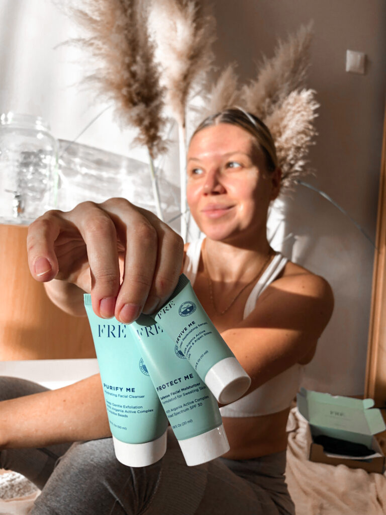 Blonde woman with products in her hand