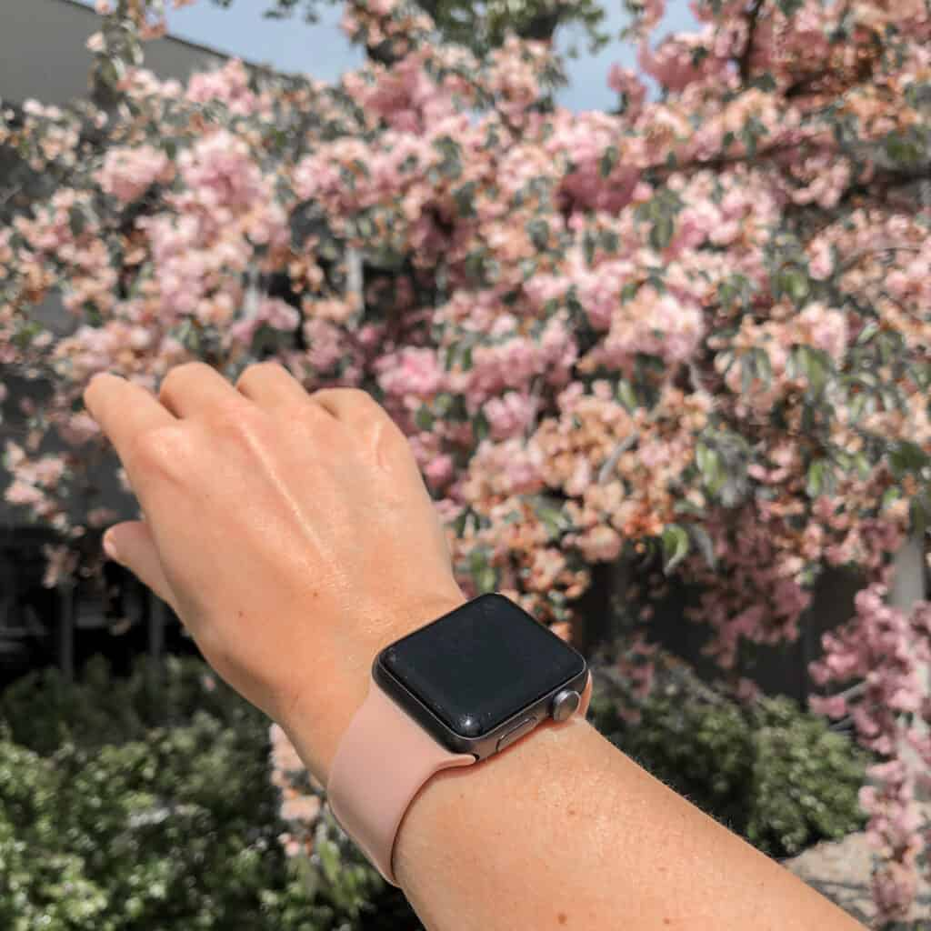 Apple Watch on wrist in nature